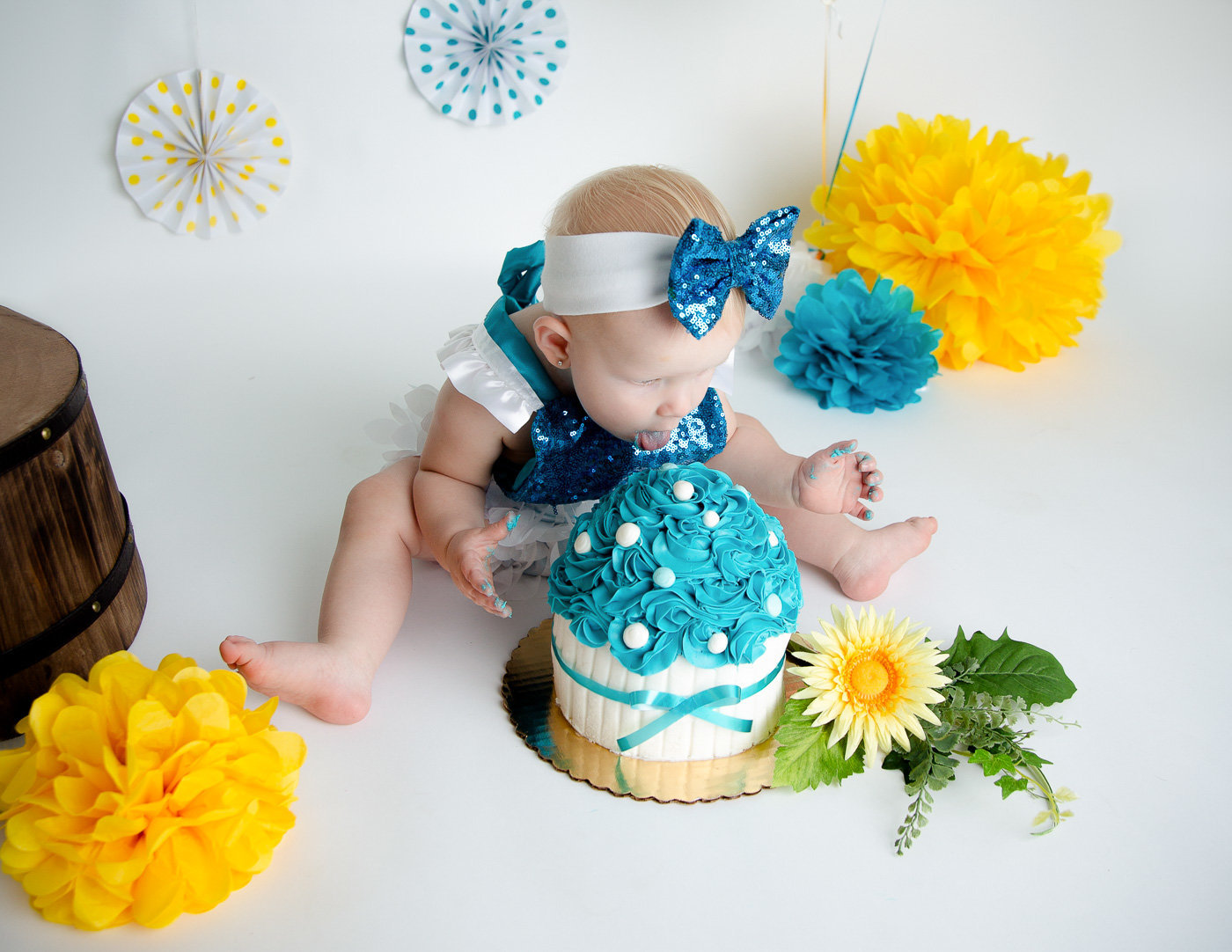 Sweet girl at her cake smash session in our studio in Rochester, NY.