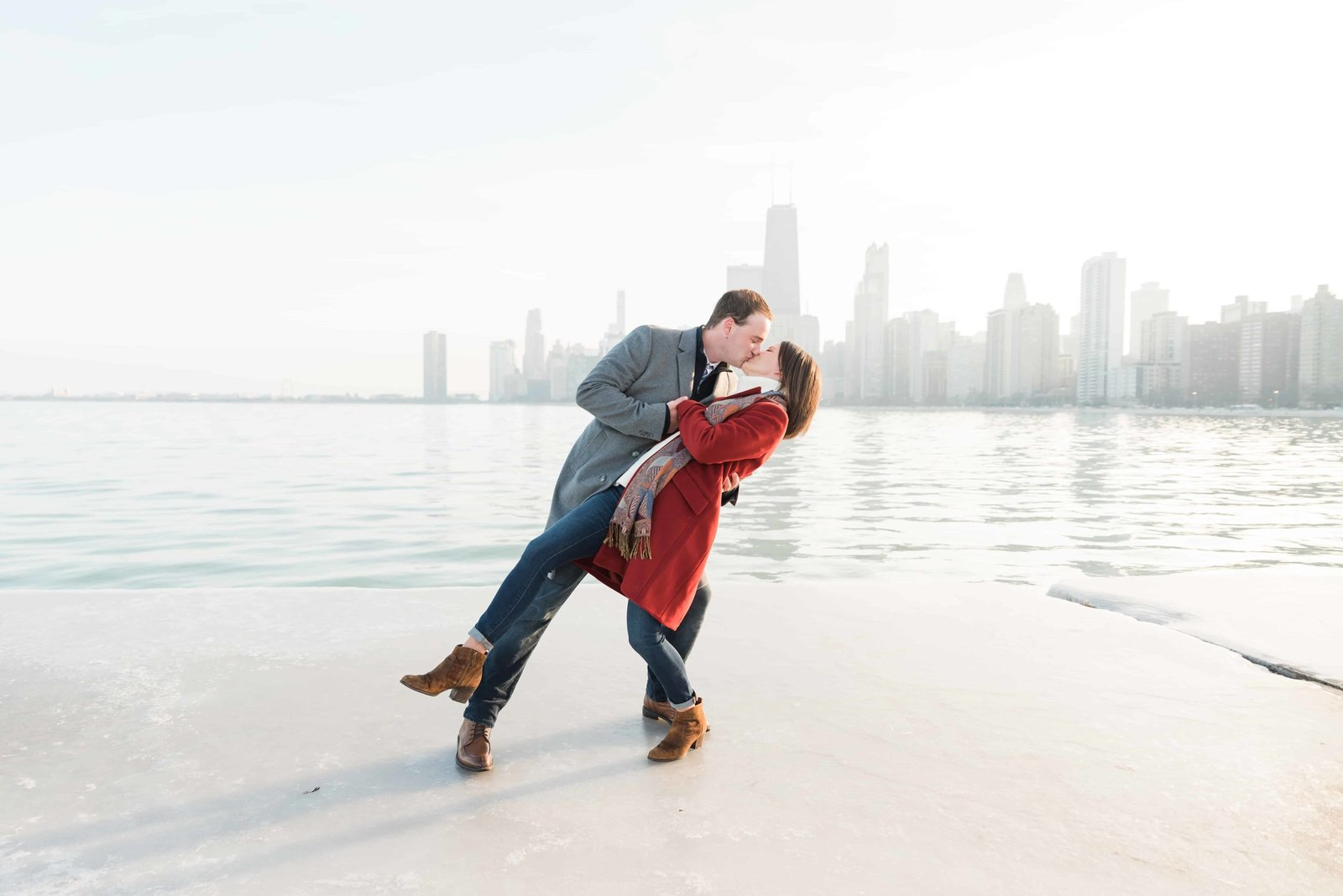 Couple kissing on the ice at North Ave Beach in Chicago