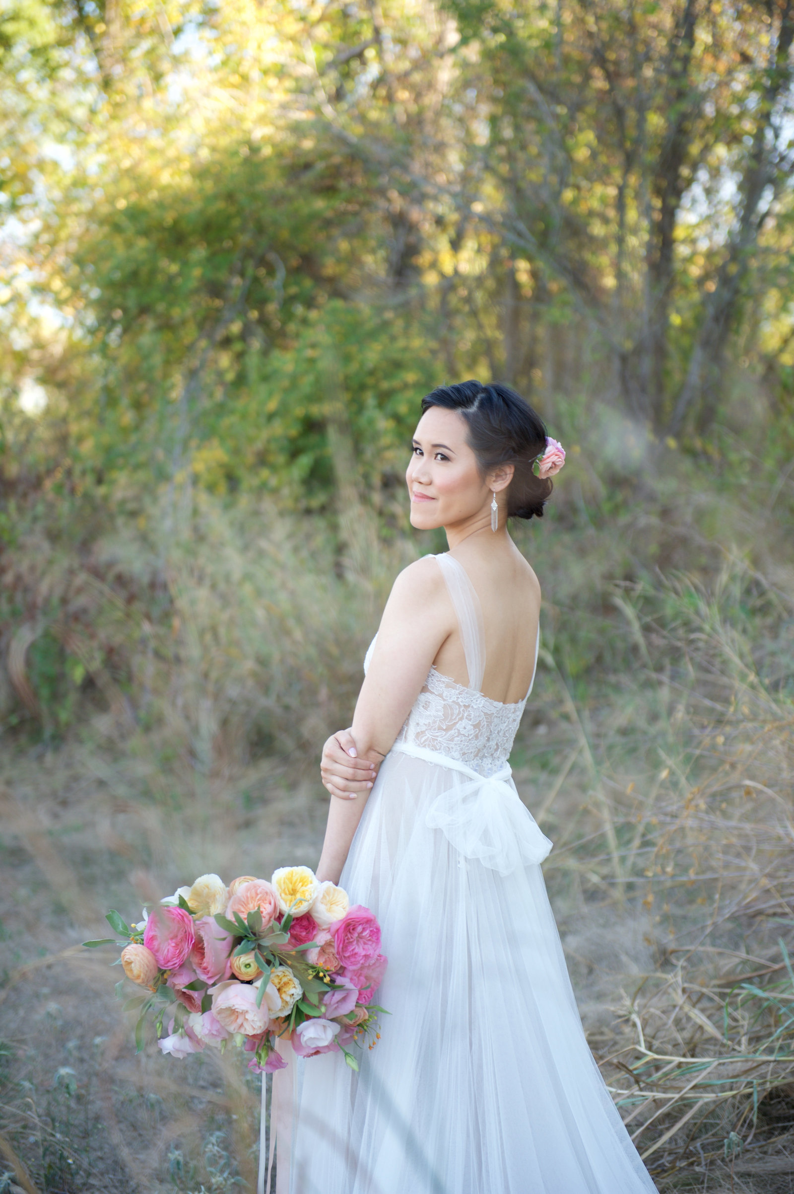 bridal portrait with bridal bouquet and beautiful updo