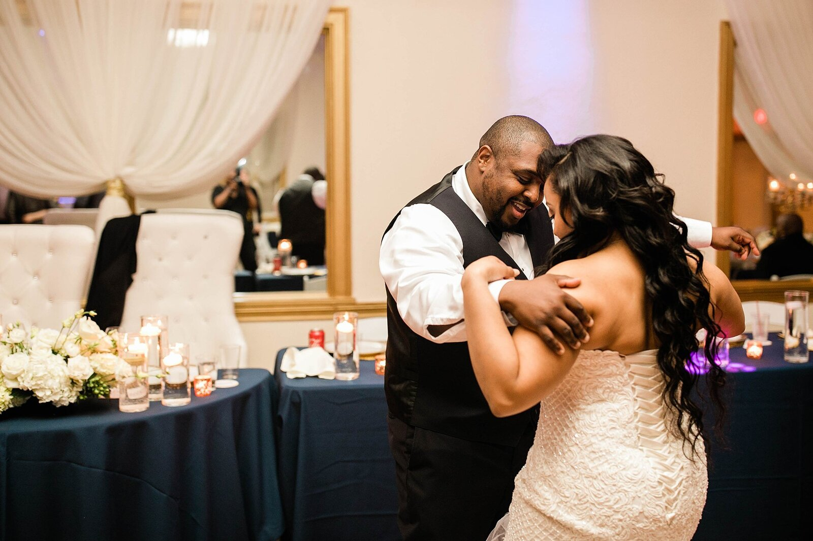 bride and groom share first dance at deleon event space