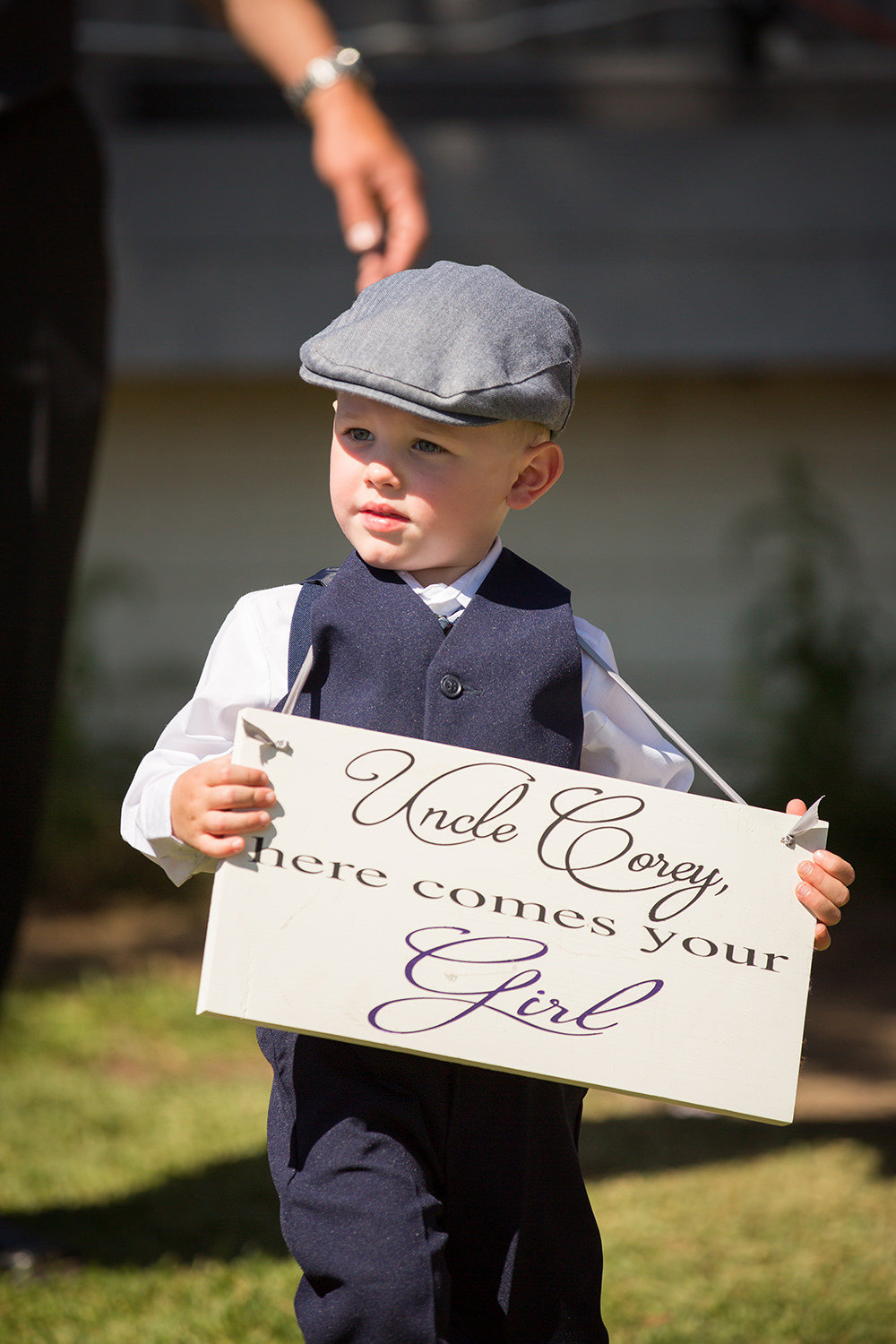 ring bearer walking down the aisle at martin johnson house
