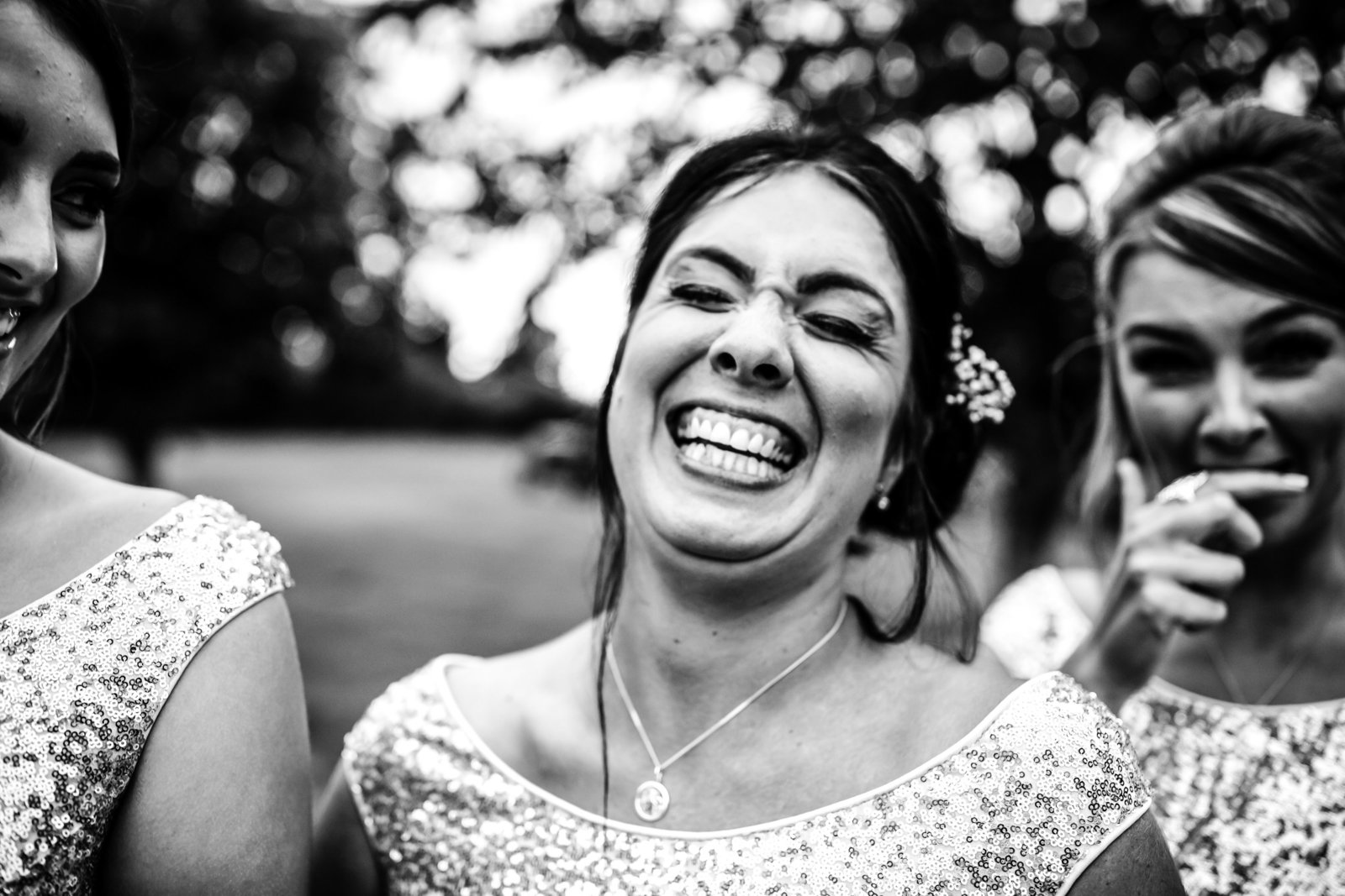 Huge smile from a Bridesmaid at a Norfolk wedding.