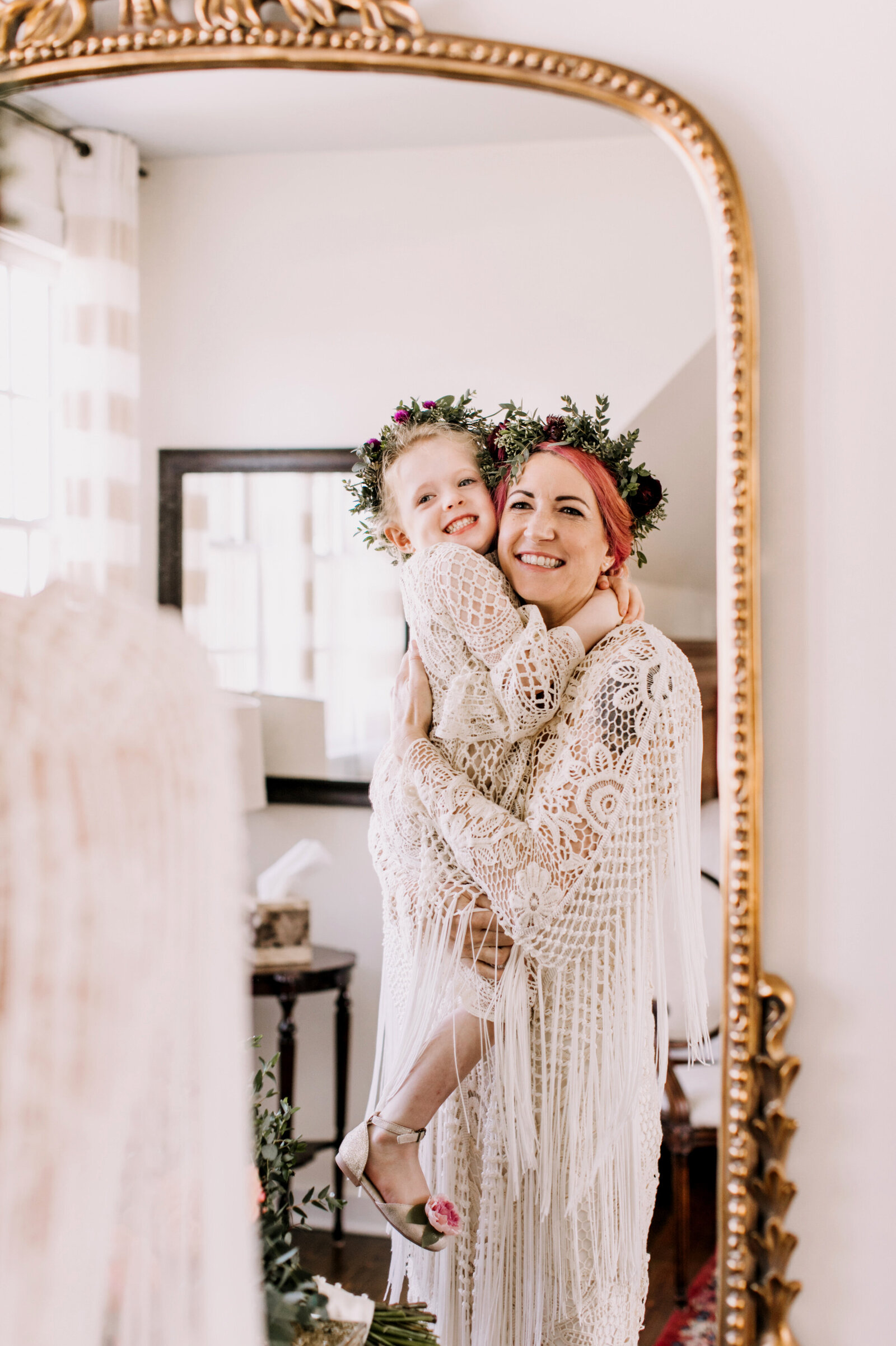 bride and daughter with flower crowns