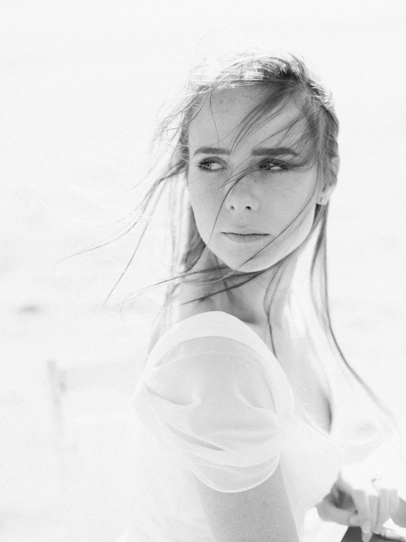 black and white windswept bride on beach