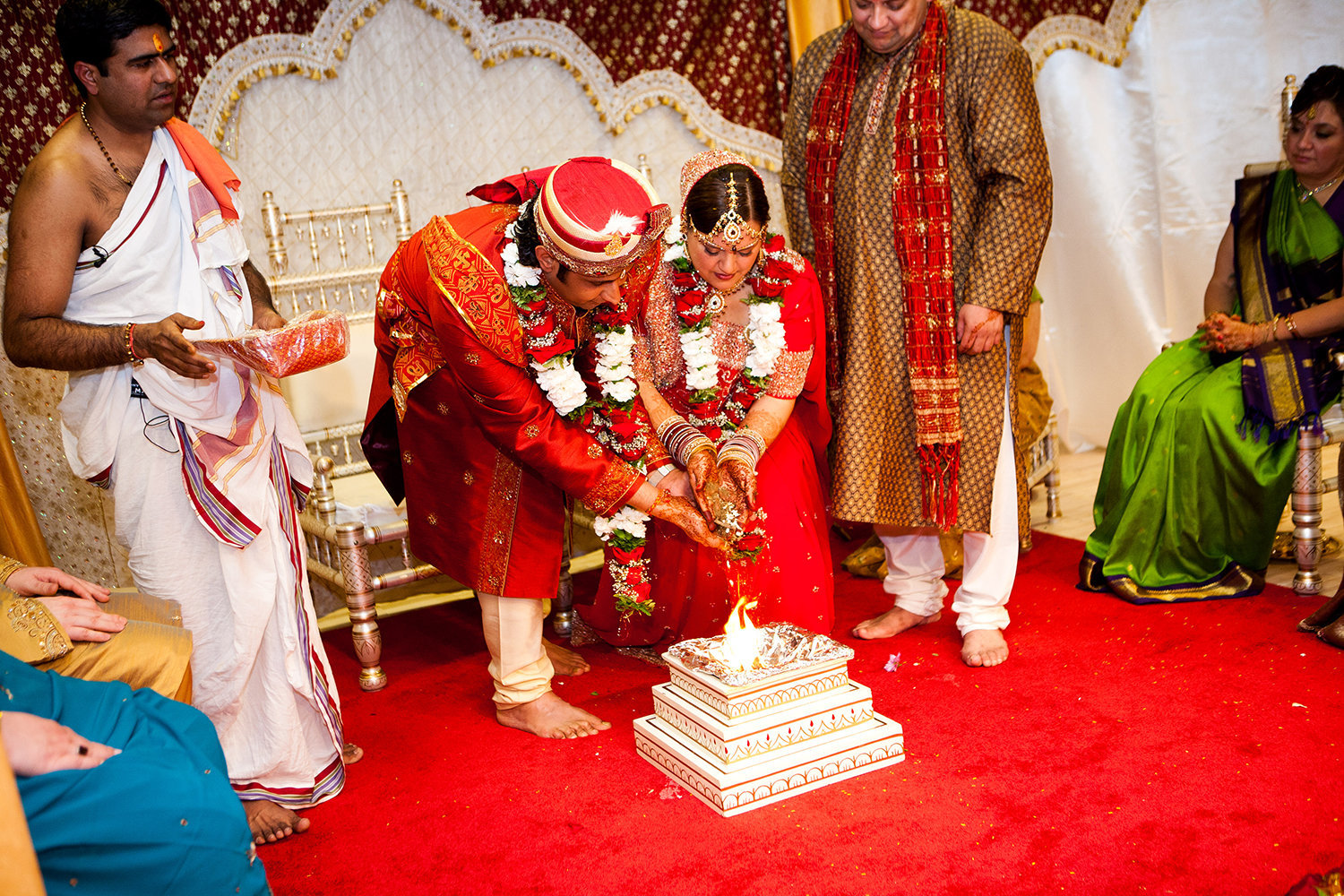 Indian bride and groom participate in mangal pherā during their Hindu wedding ceremony