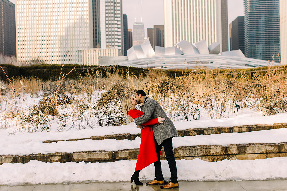 Couple kiss in Chicago's Lurie Garden for a winter engagement photo in Chicago.