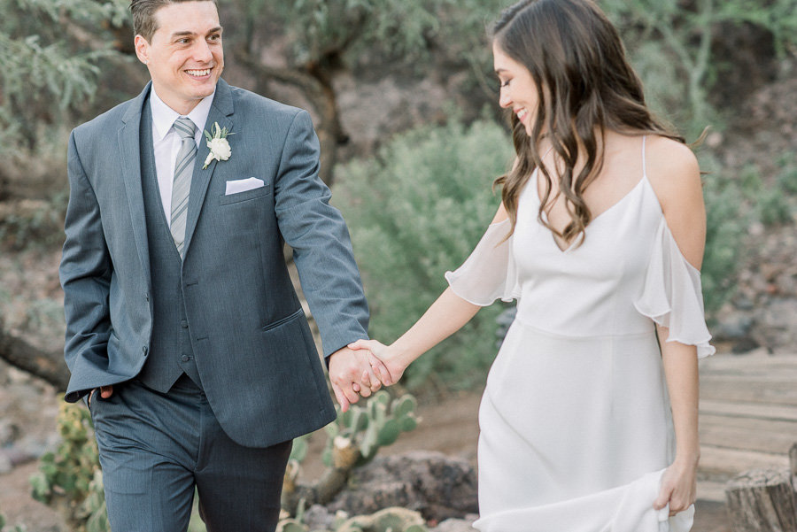 Romantic Gather Estate Wedding Photo of Bride and Groom Holding Hands | Tucson Wedding Photographer | West End Photography