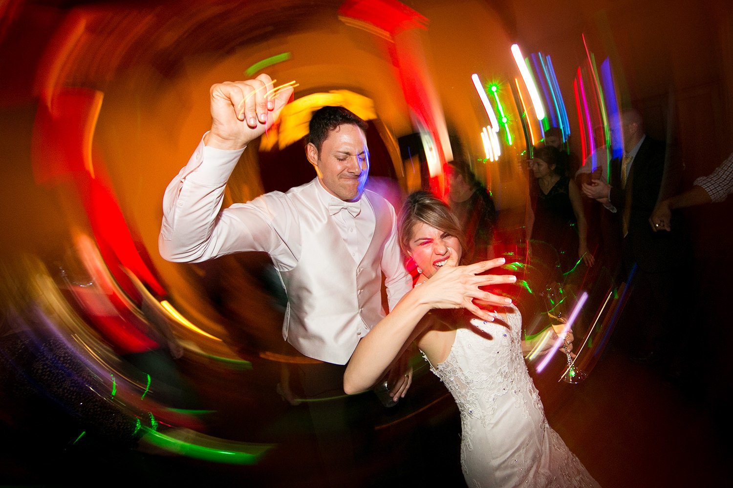 bride and groom dancing having fun don room