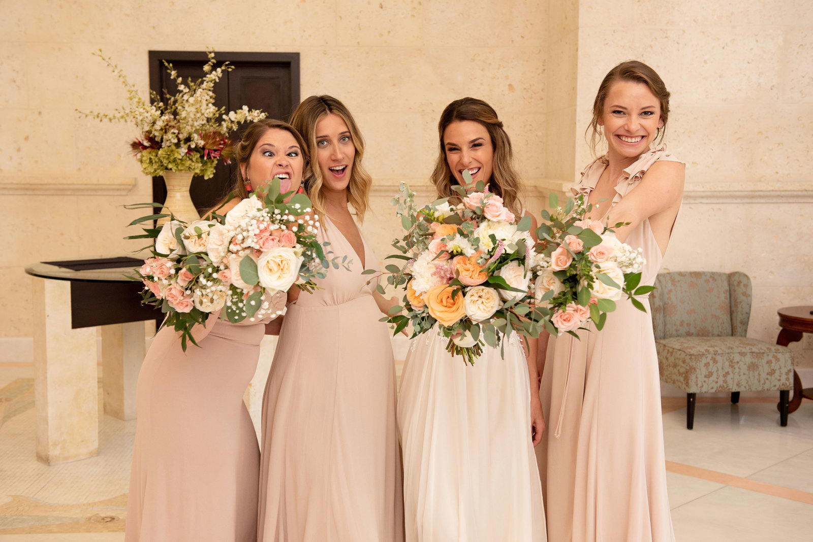 Bride and bridesmaids with bouquets at Atlantis Banquet and Events