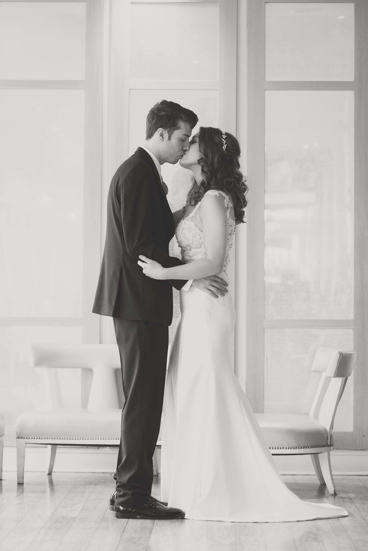Bride and groom kissing in black and white at  Allegria Hotel