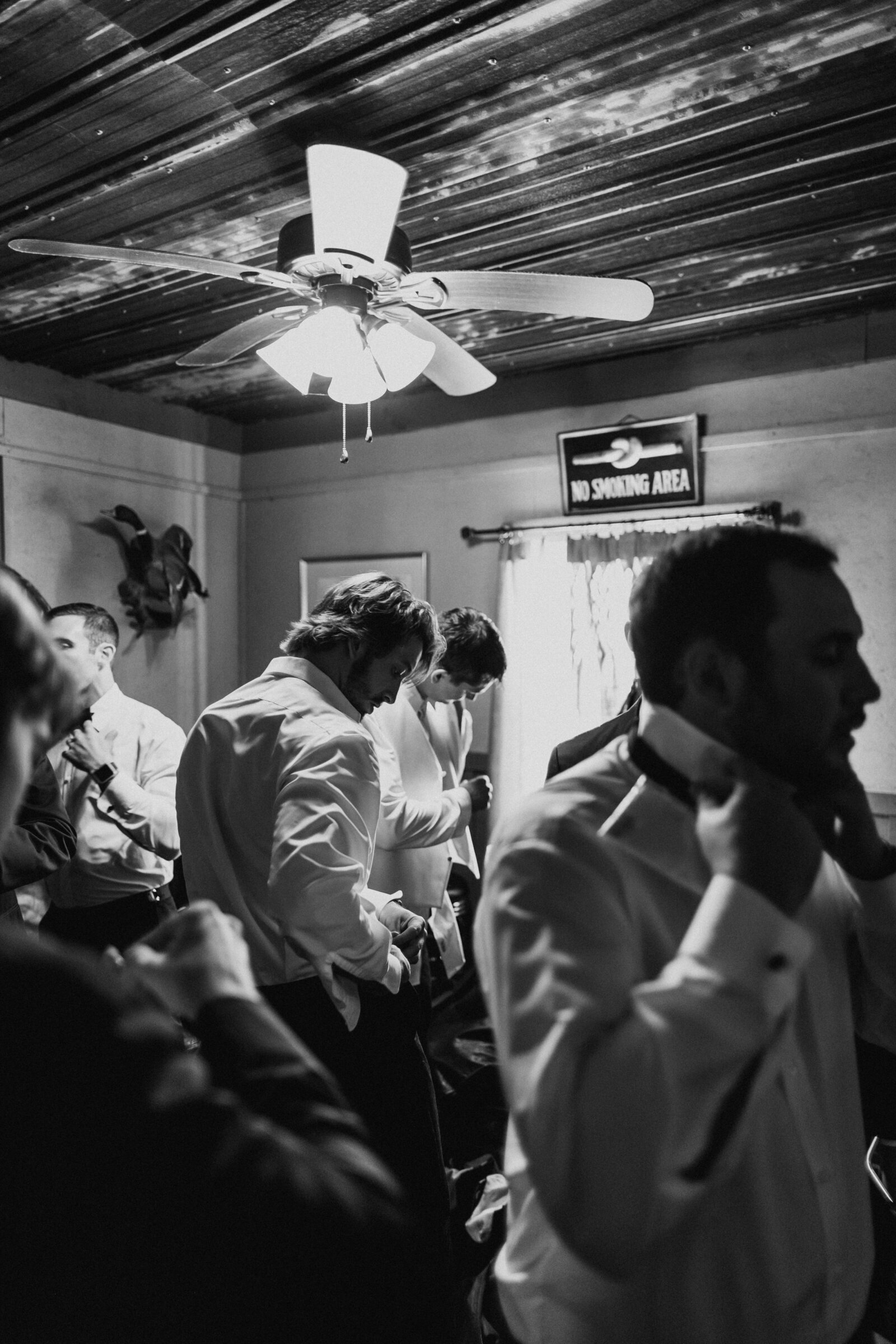 J.Michelle Photography photographs groomsmen getting ready at vintage oaks farm wedding in Athens, Ga