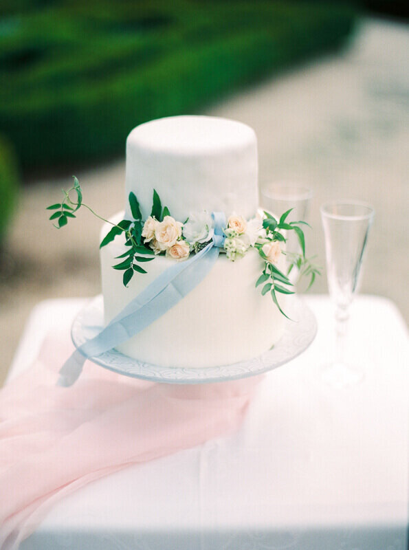 white two tier cake with florals and silk ribbon  intimate wedding in Portugal