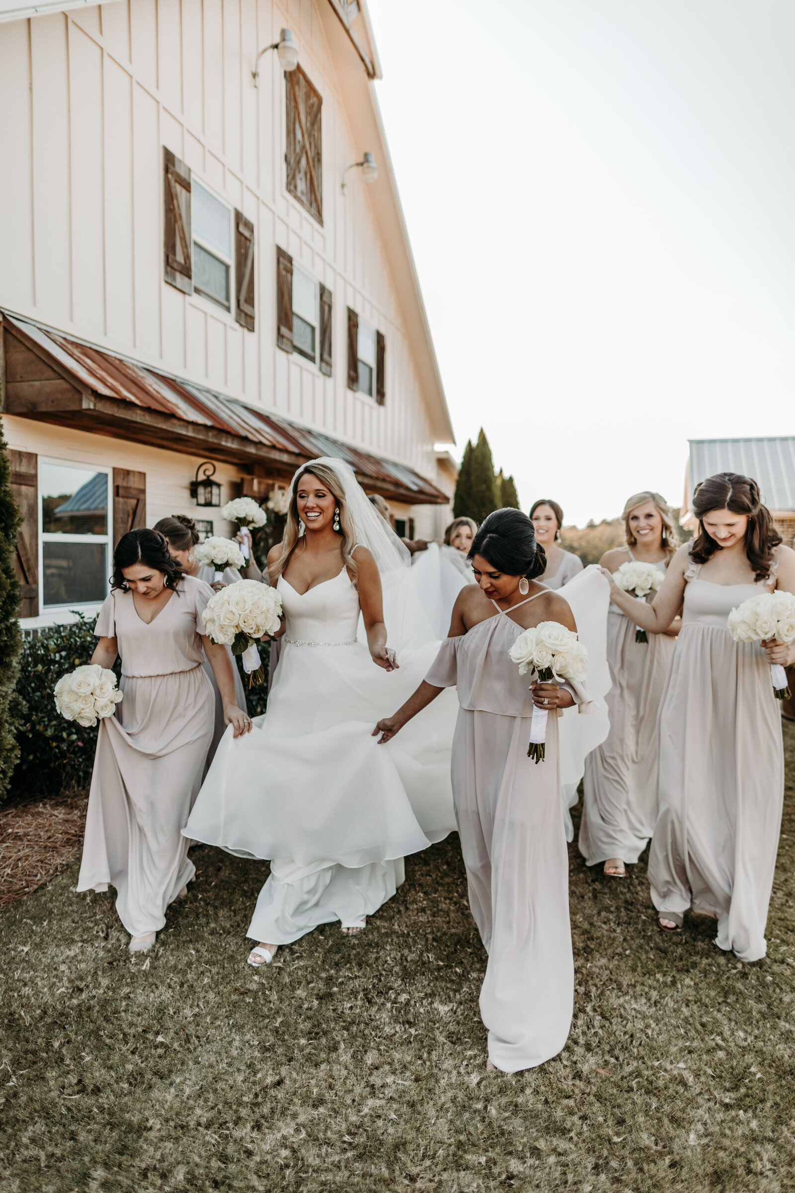 J.Michelle Photography photographs bride and bridesmaids at vintage oaks farm wedding in Athens, Ga