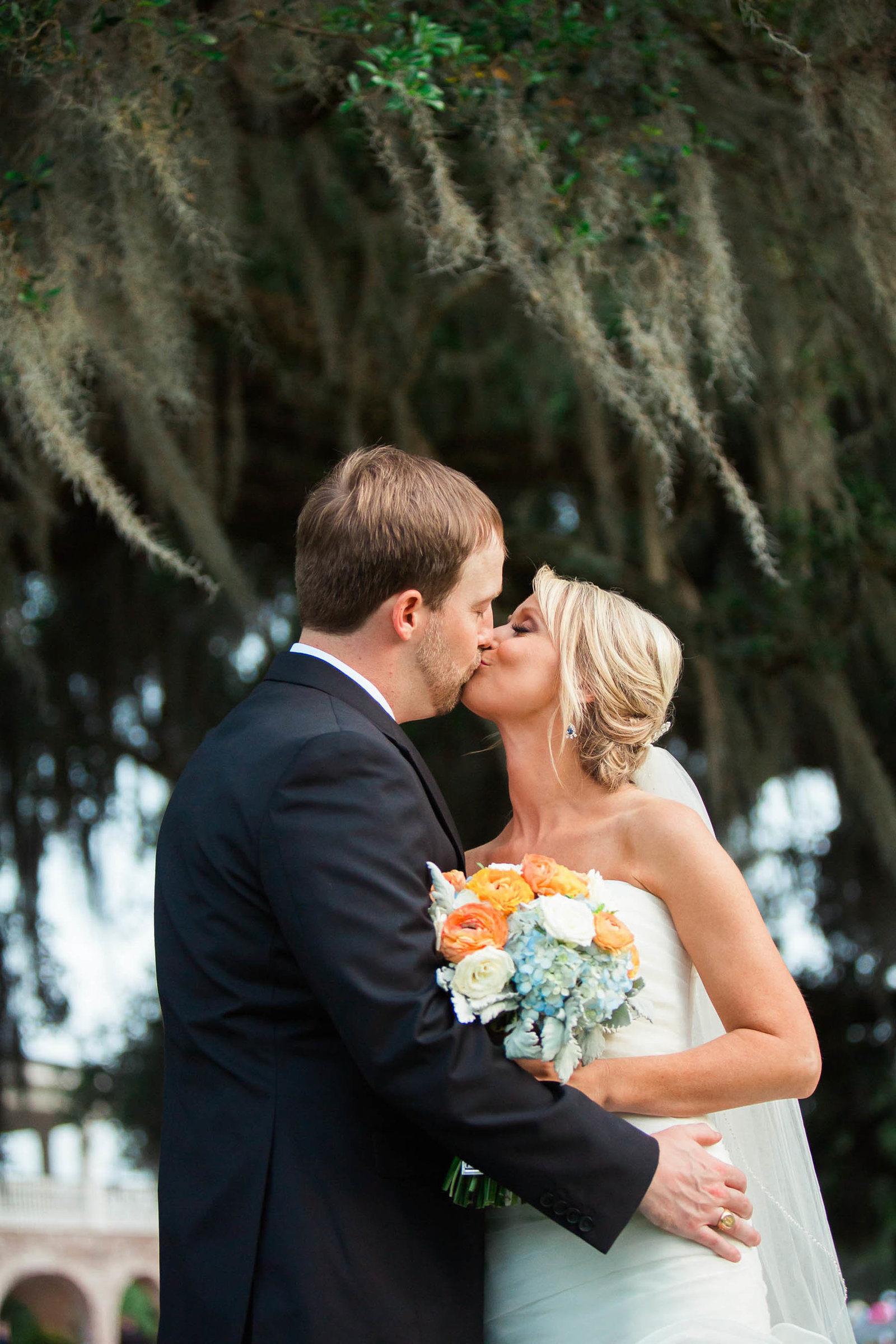 Bride and groom smile under oak trees, Dunes West Golf and River Club, Mt Pleasant, South Carolina