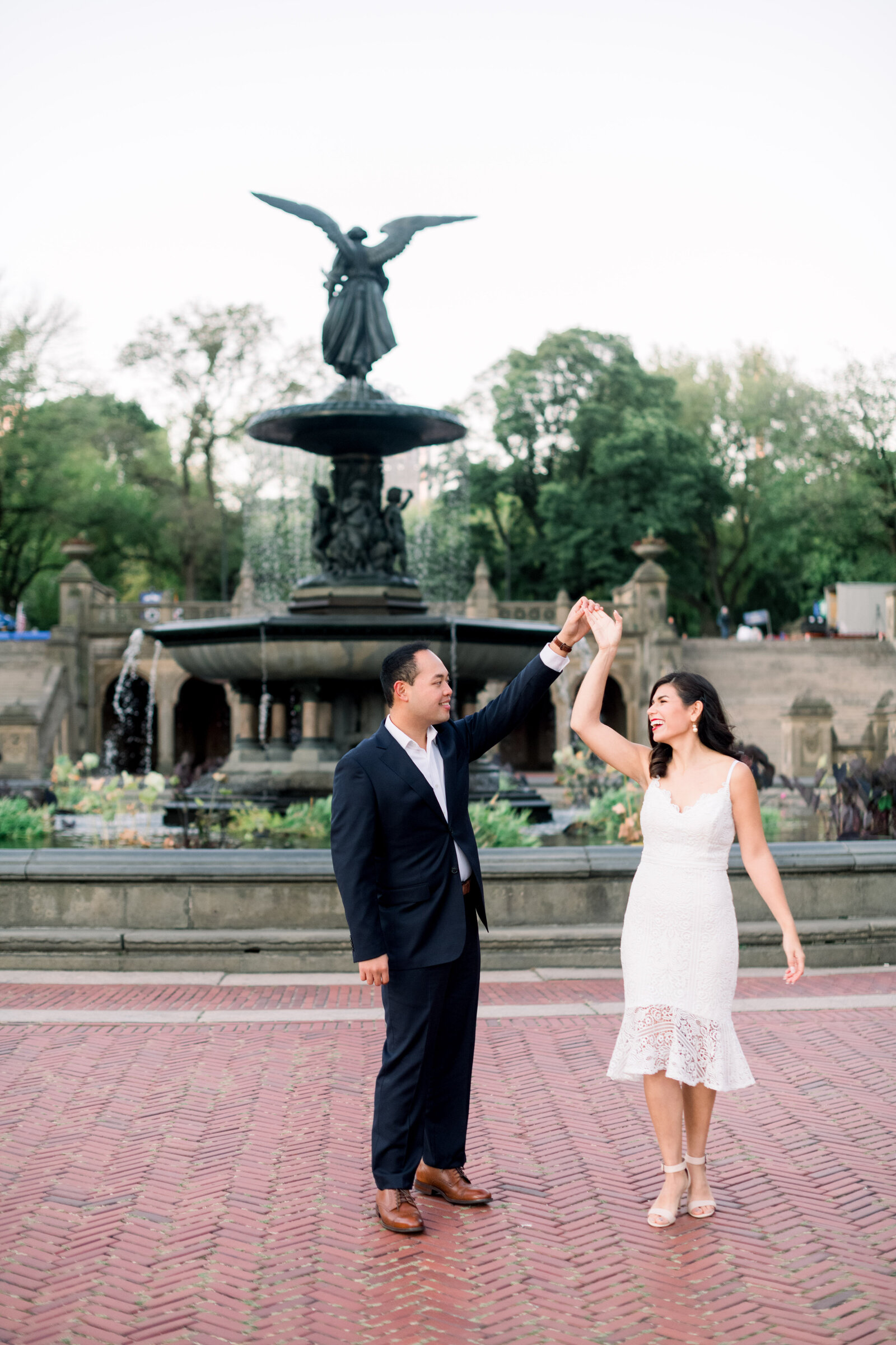 Fine art elegant refined New York City engagement session at Bethesda Terrace and Fountain and Bow Bridge by Liz Andolina Photography
