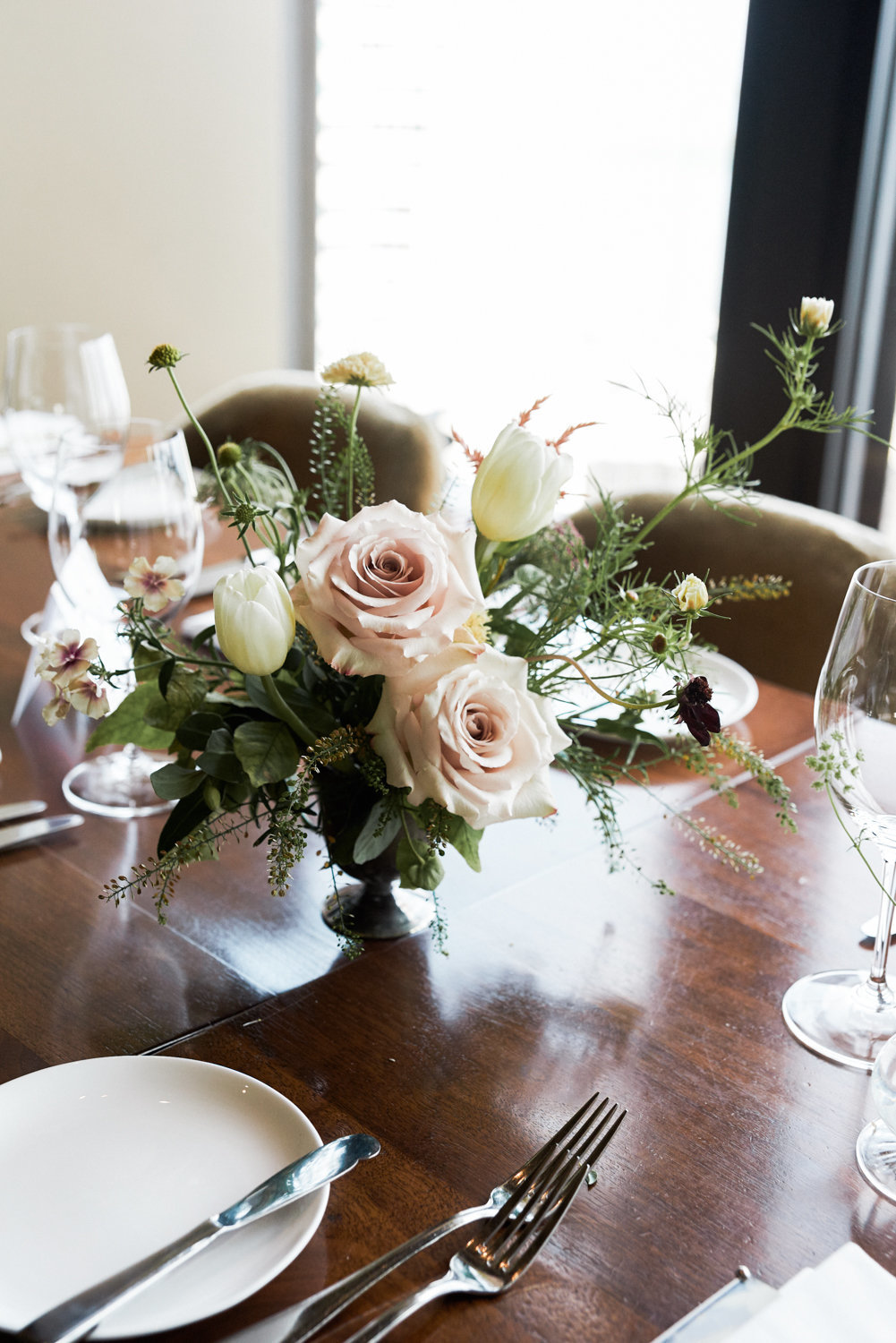 Soft pink rose centrepieces by Patchouli florist in Toronto