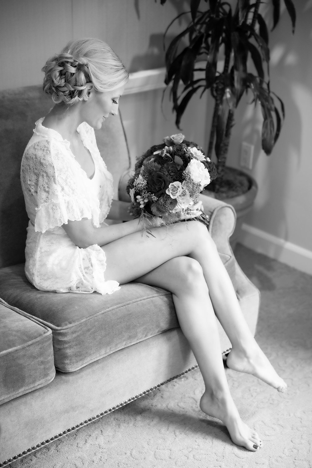 Elegant moment captured in black and white of a bride getting ready