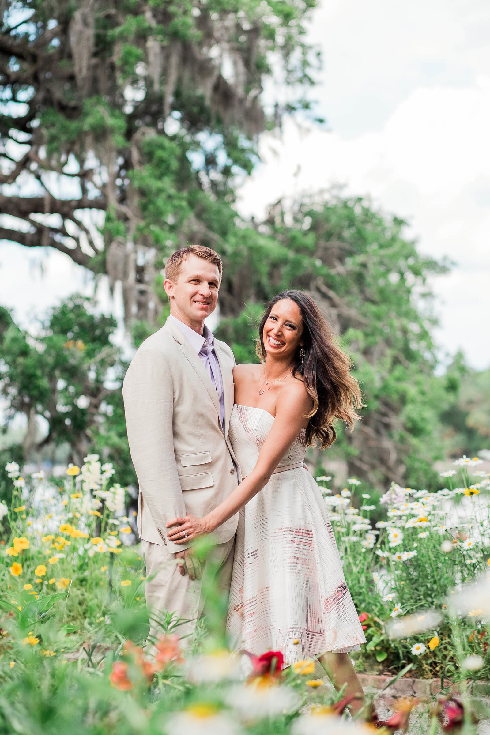 Engaged couple stand among wildflowers, Magnolia Plantation, Charleston, South Carolina