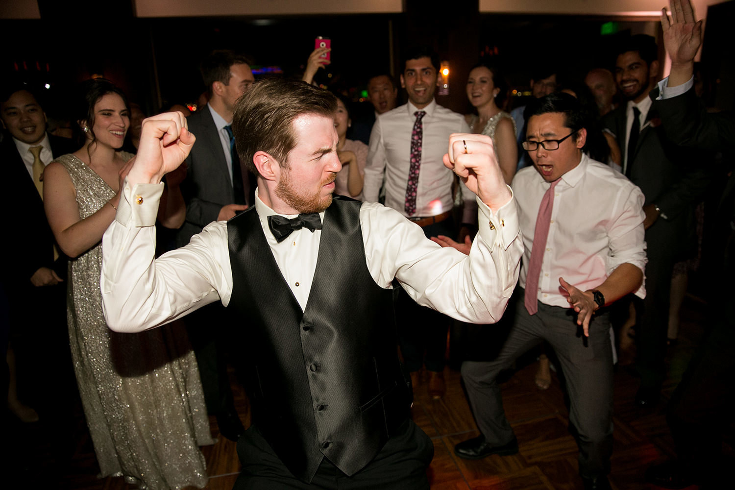 groom dancing at reception being silly