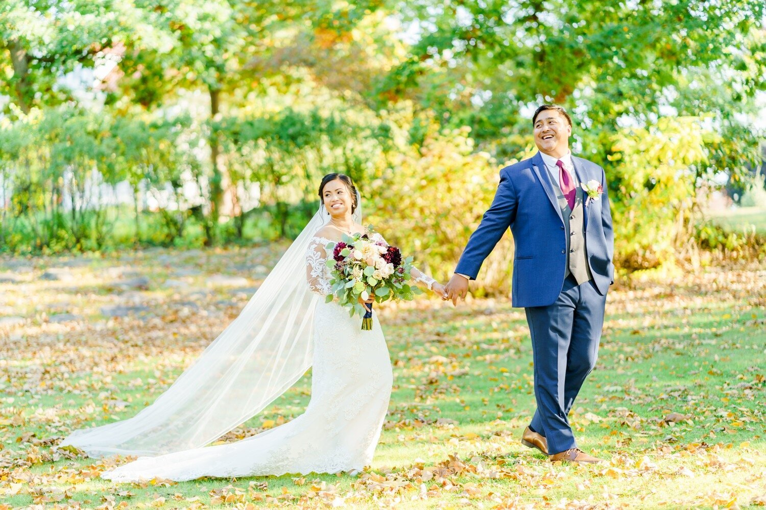 New Hampshire bride and groom holding hands and laughing