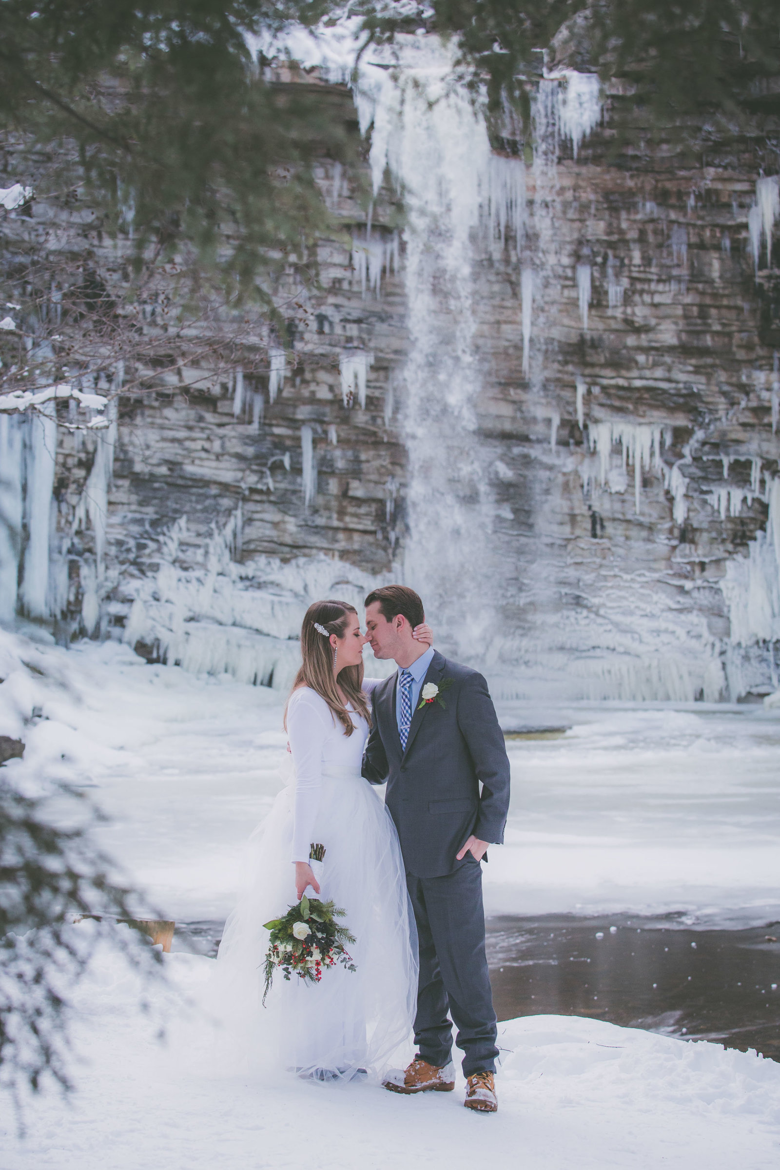 A couple gets close with waterfall view during their hiking elopement.
