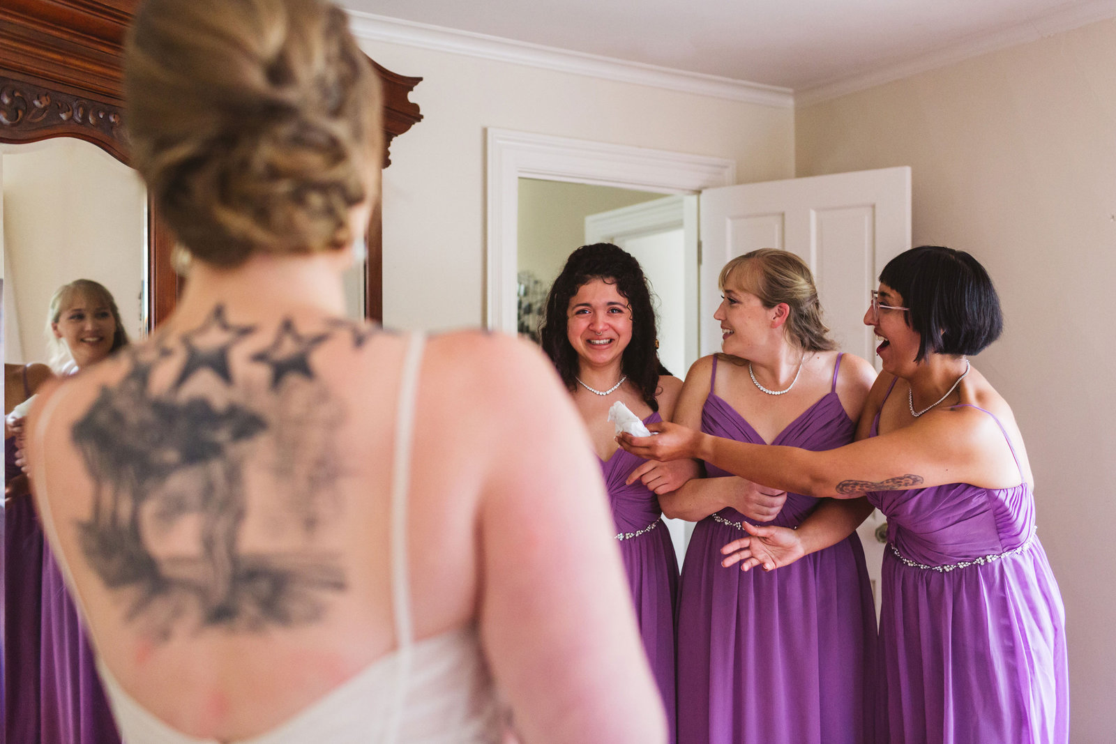 monte verde in emotional wedding moment as one bridesmaid hands another bridesmaid a tissue