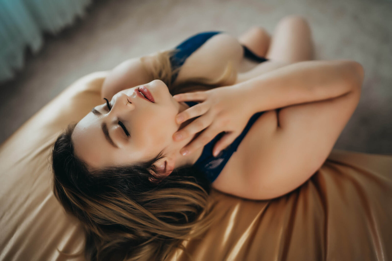 boudoir pose touching neck