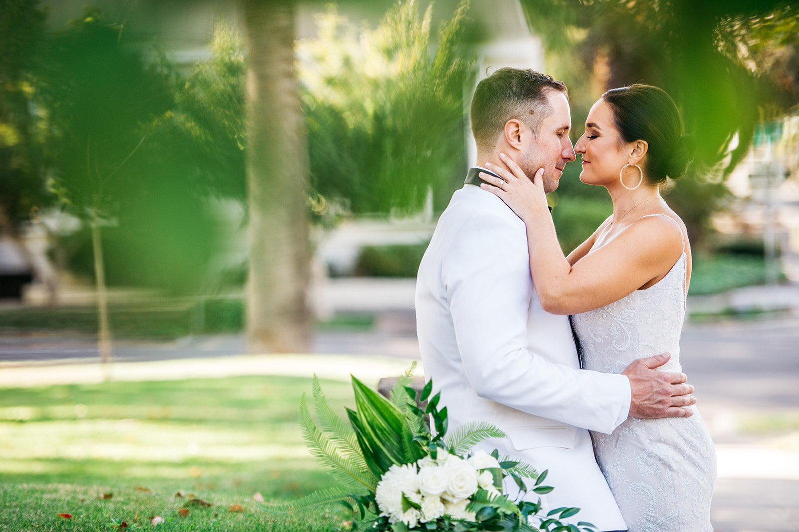 Couple engages in a kiss for a special moment after becoming husband and wife.