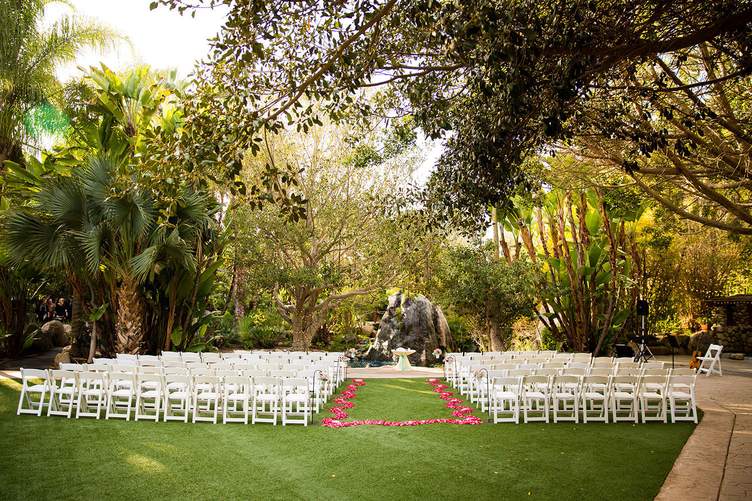 ceremony space with pink rose petals