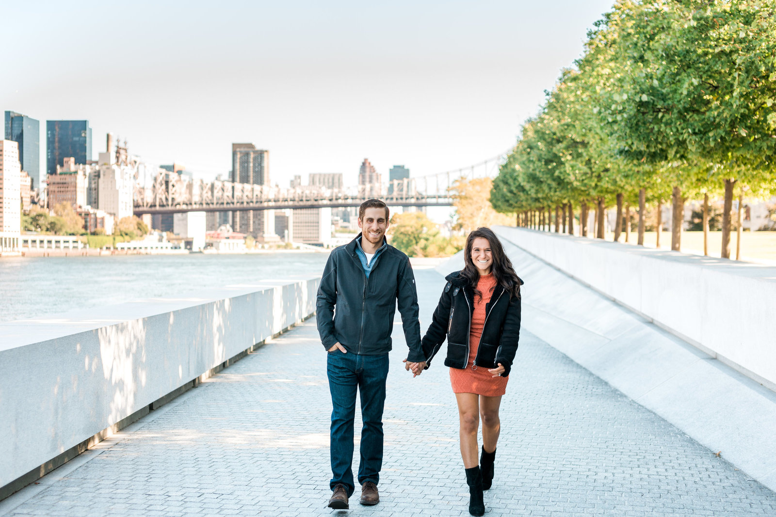 Couple holding hands after getting engaged in Manhattan, New York