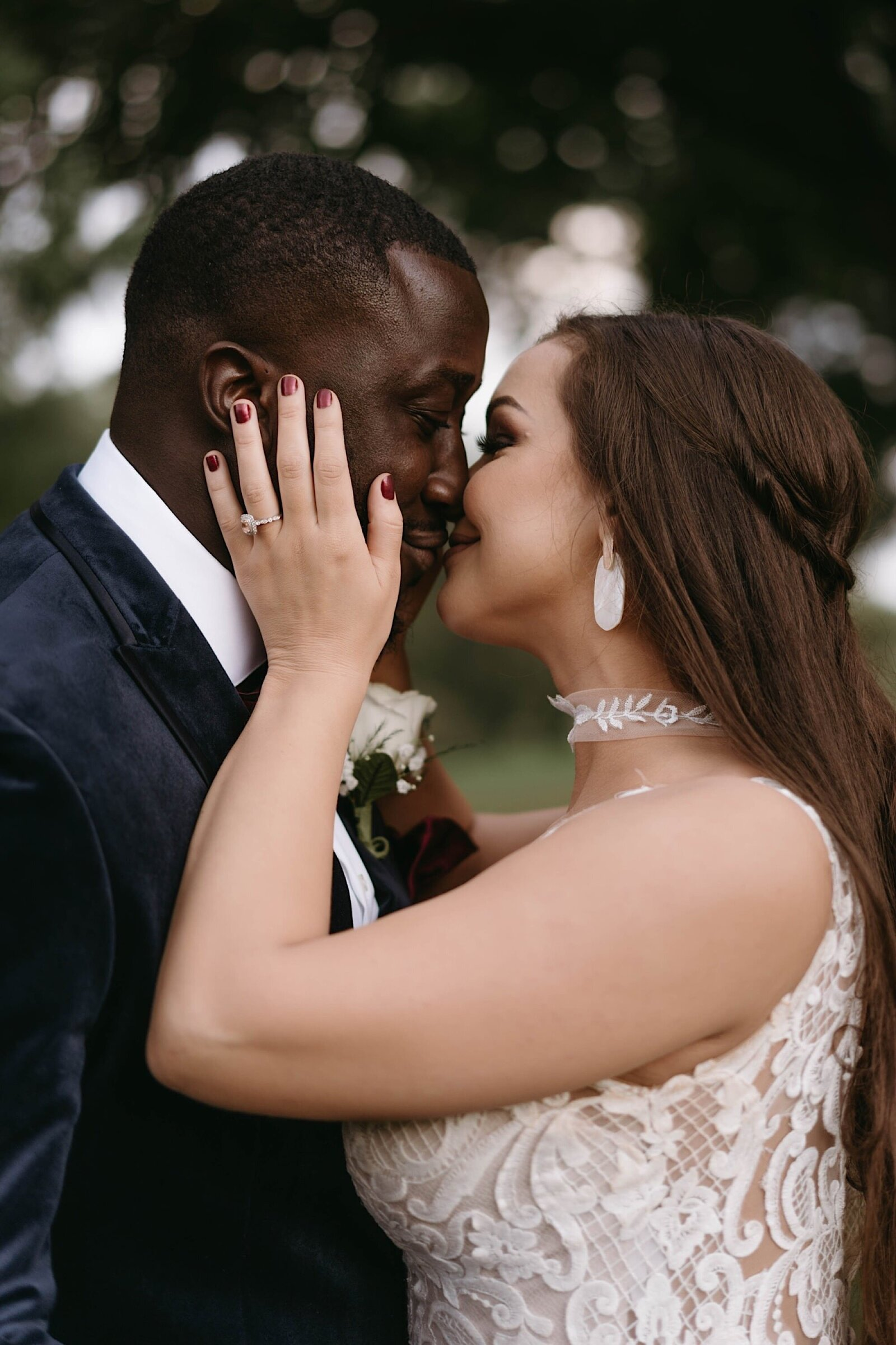 bride and groom kiss at intimate elopement in Kansas City