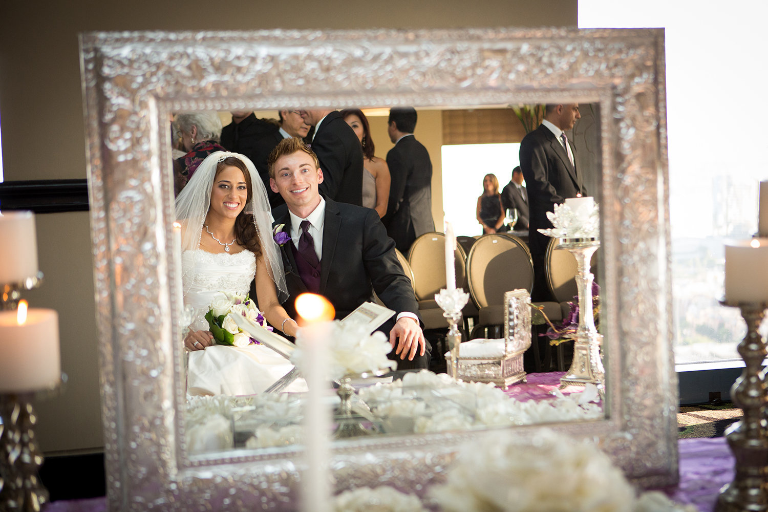 Portrait of bride and groom at persian wedding through mirror
