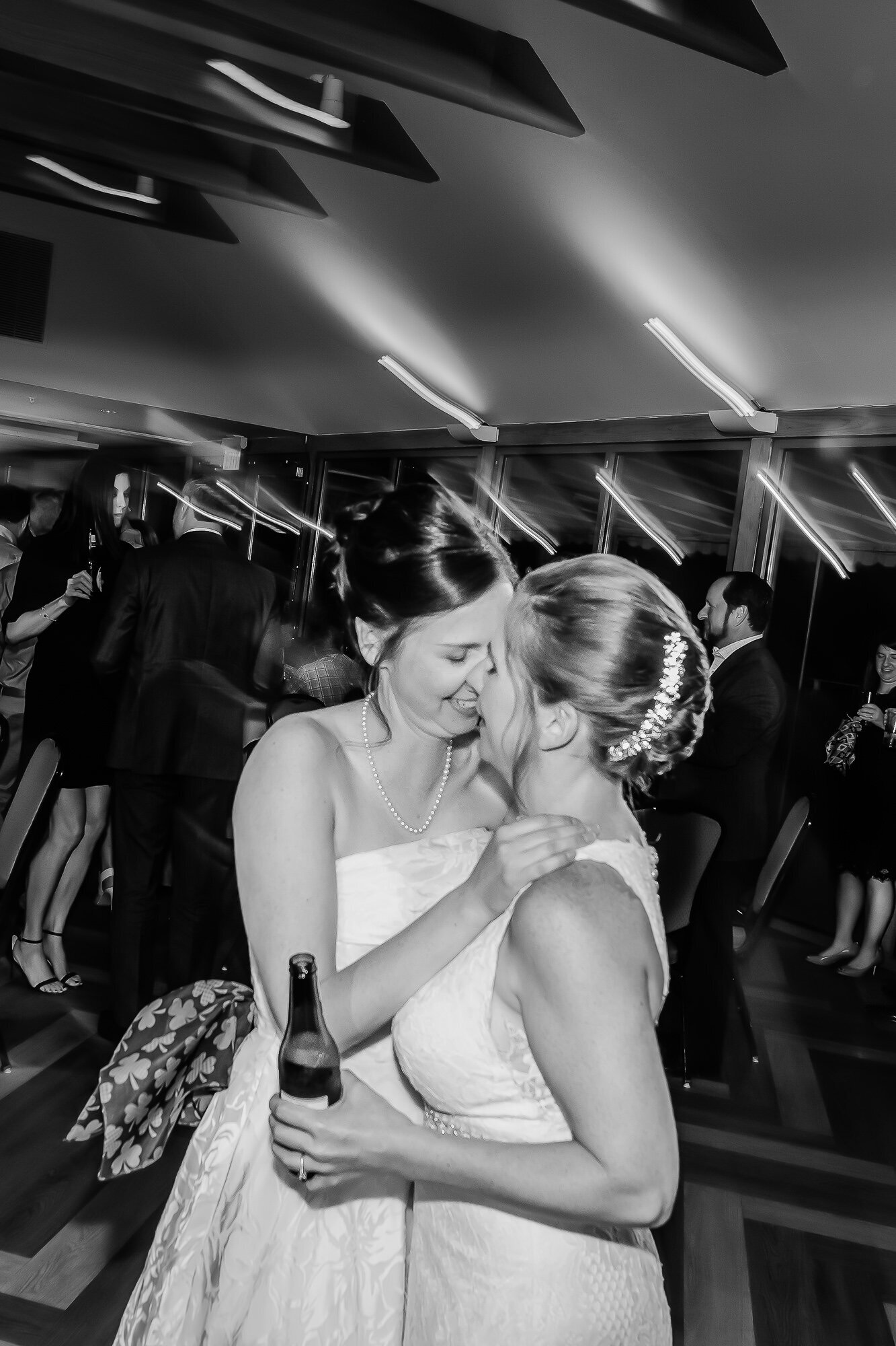 Candid wedding photo of LGBT brides at their St. Louis wedding reception