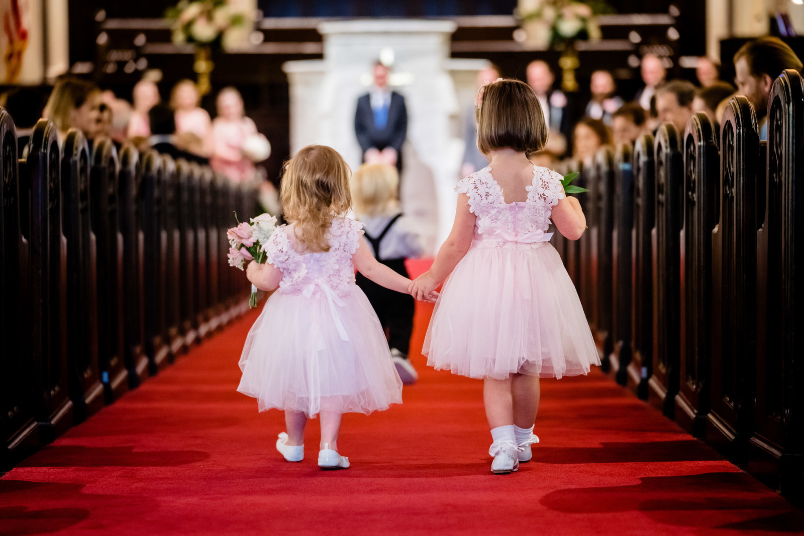 flower girls walking down aisle
