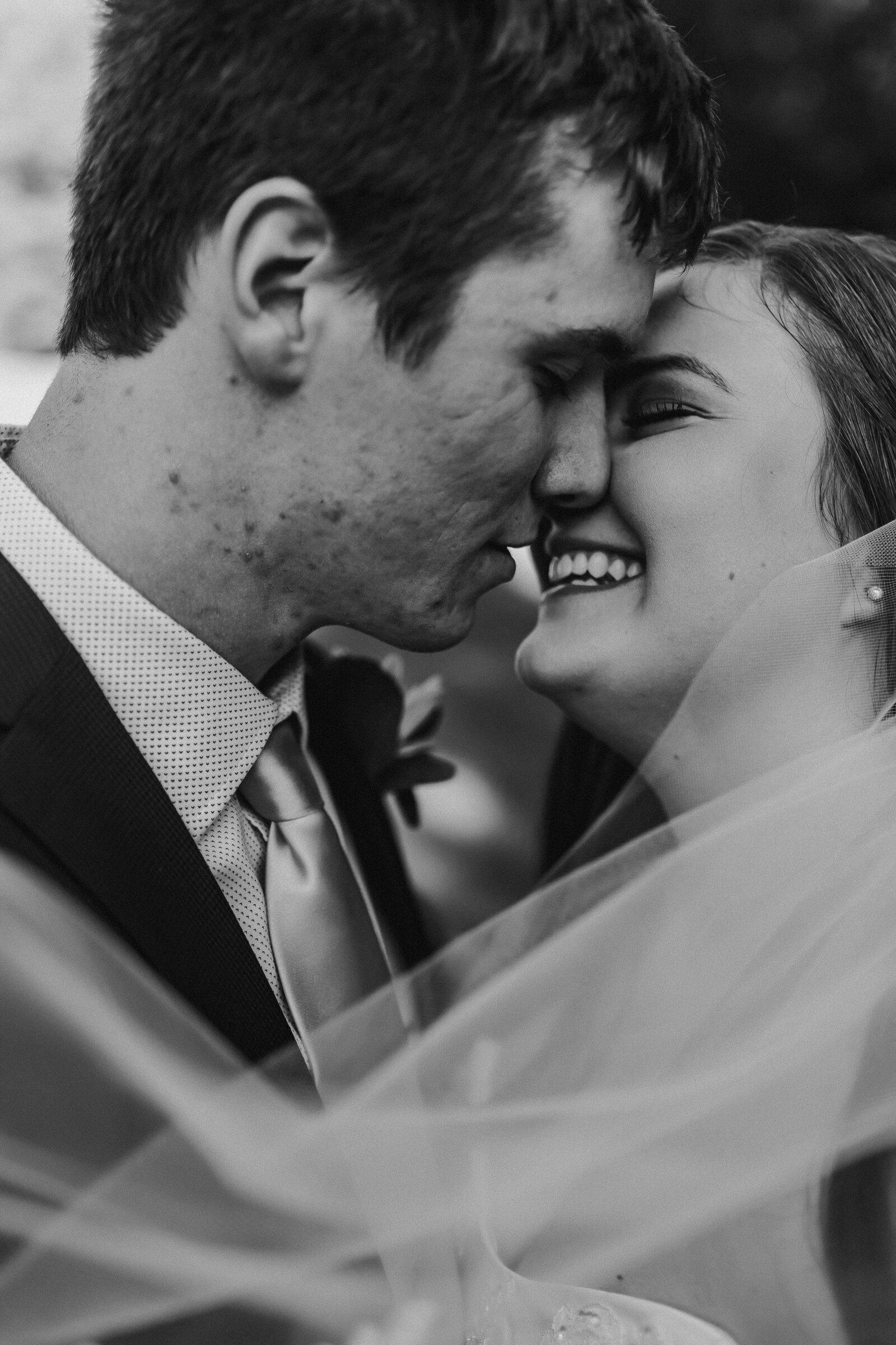 J.Michelle Photography photographs bride and groom close up kiss