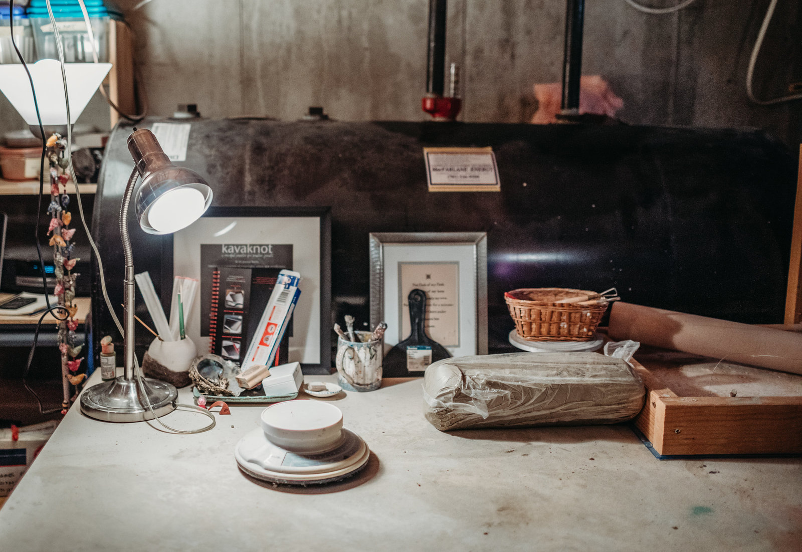 a potters work station in low light