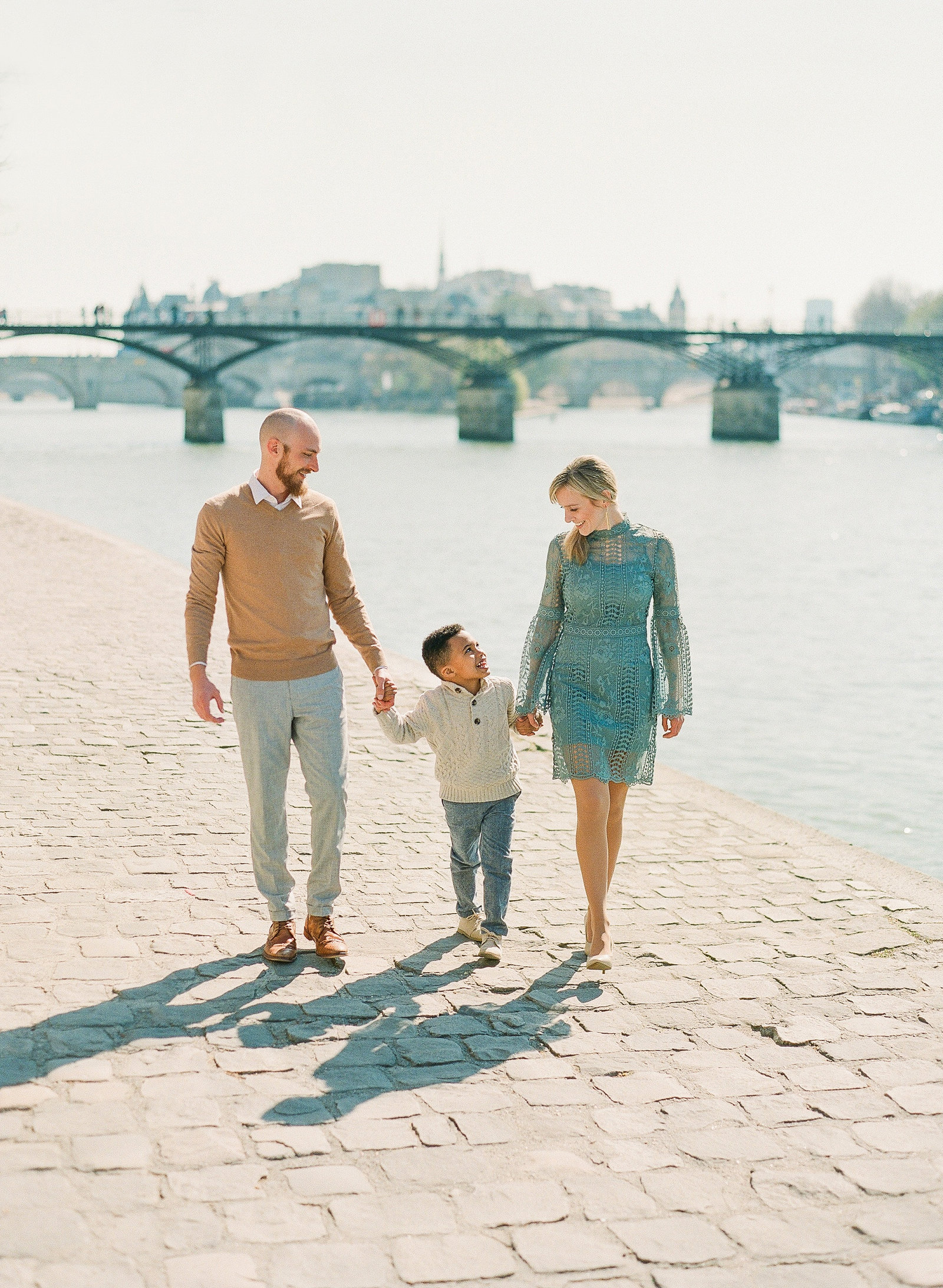 Charleston Wedding photographersRoss and Amy with son of Amy Mulder Photography by the River Sienne in Paris France