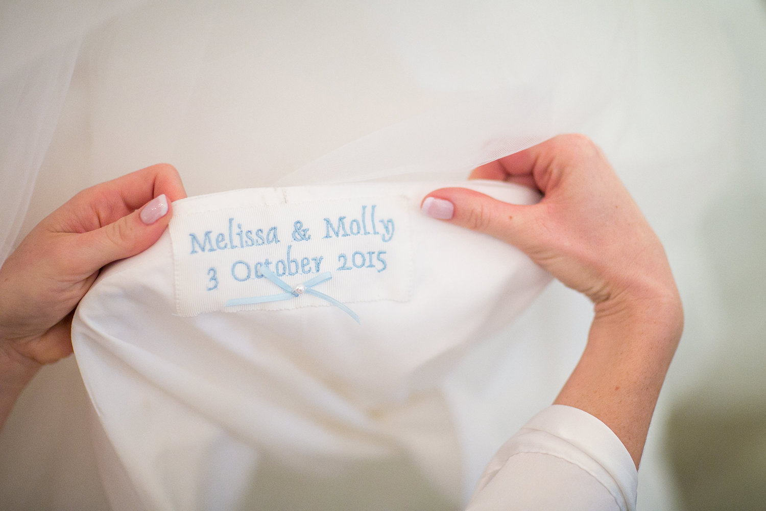 Custom embroidery on a bride's wedding dress