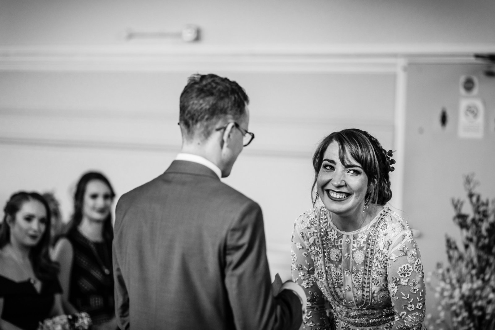 Bride laughs happy tears with her Groom during their Norfolk registry office wedding ceremony