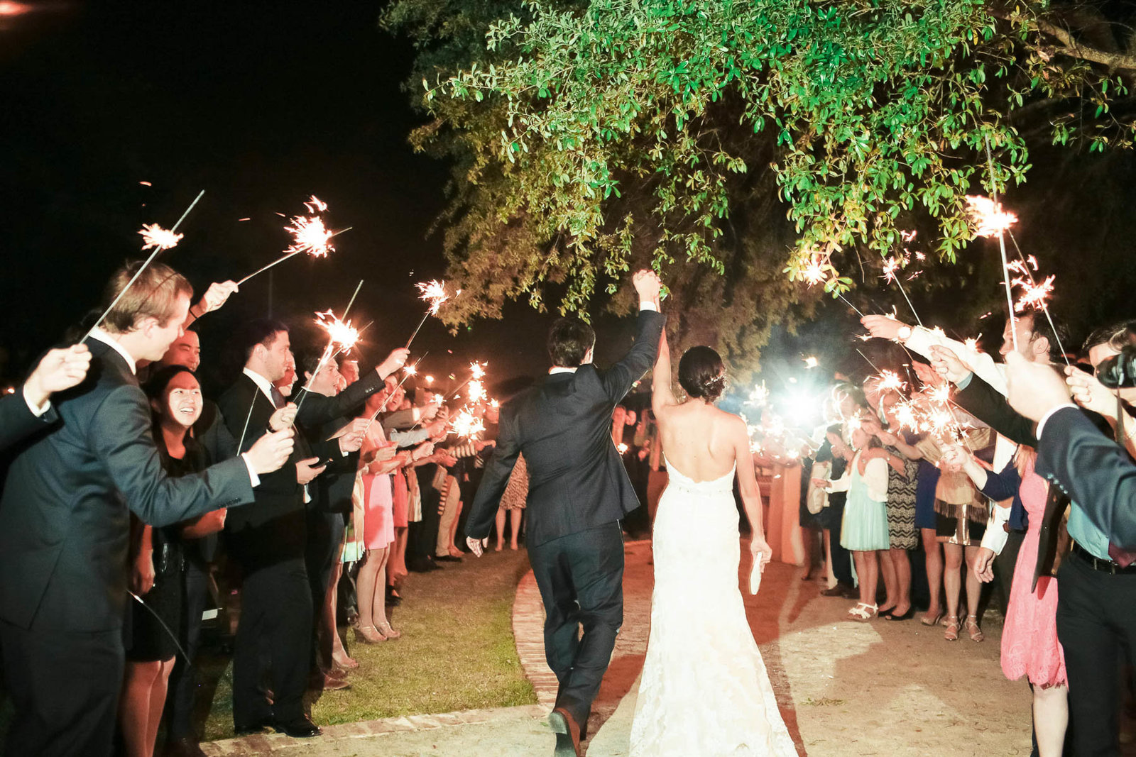 Bride and groom have sparkler exit, I'ON Creek Club, Mt Pleasant, South Carolina
