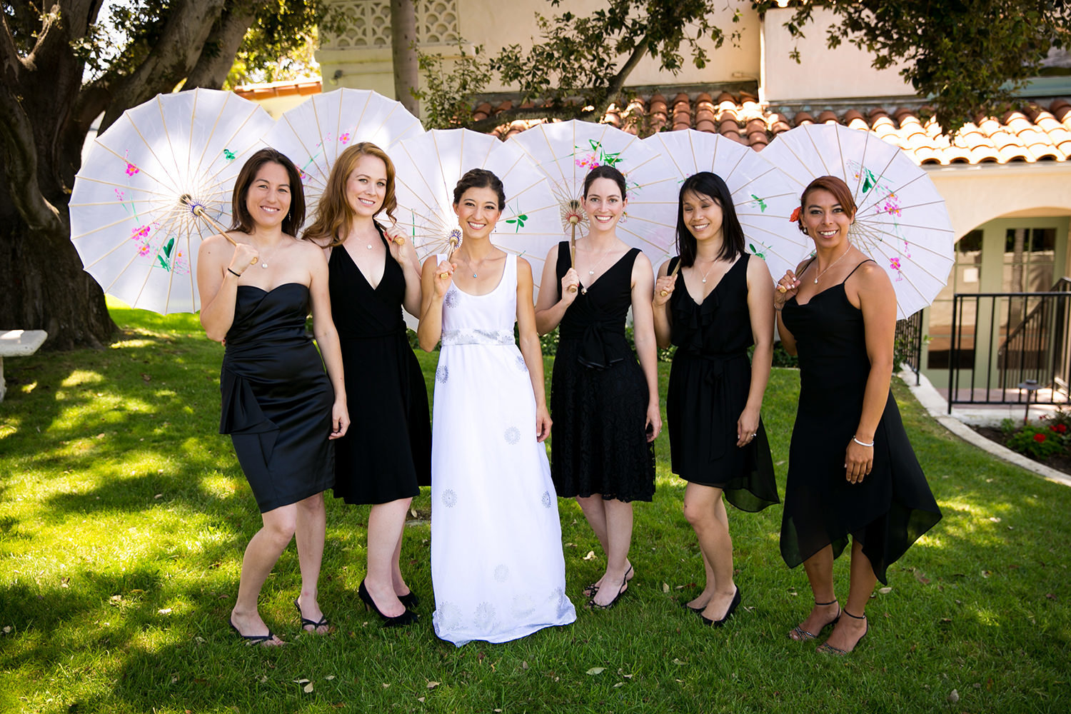 bride with bridesmaids and black umbrellas