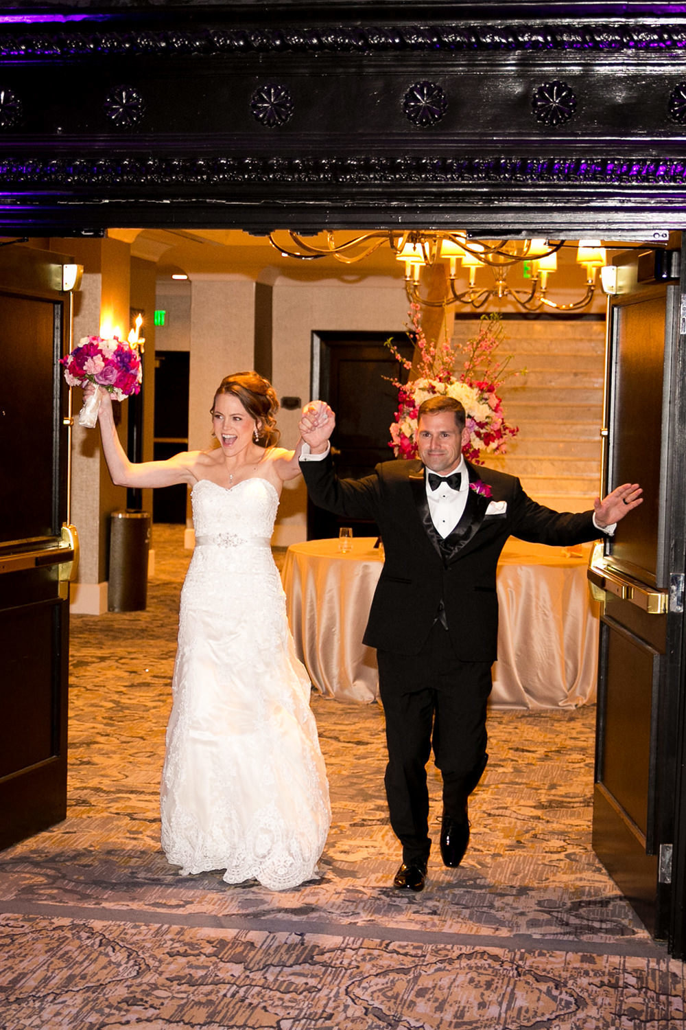 bride and groom walking into reception at us grant hotel