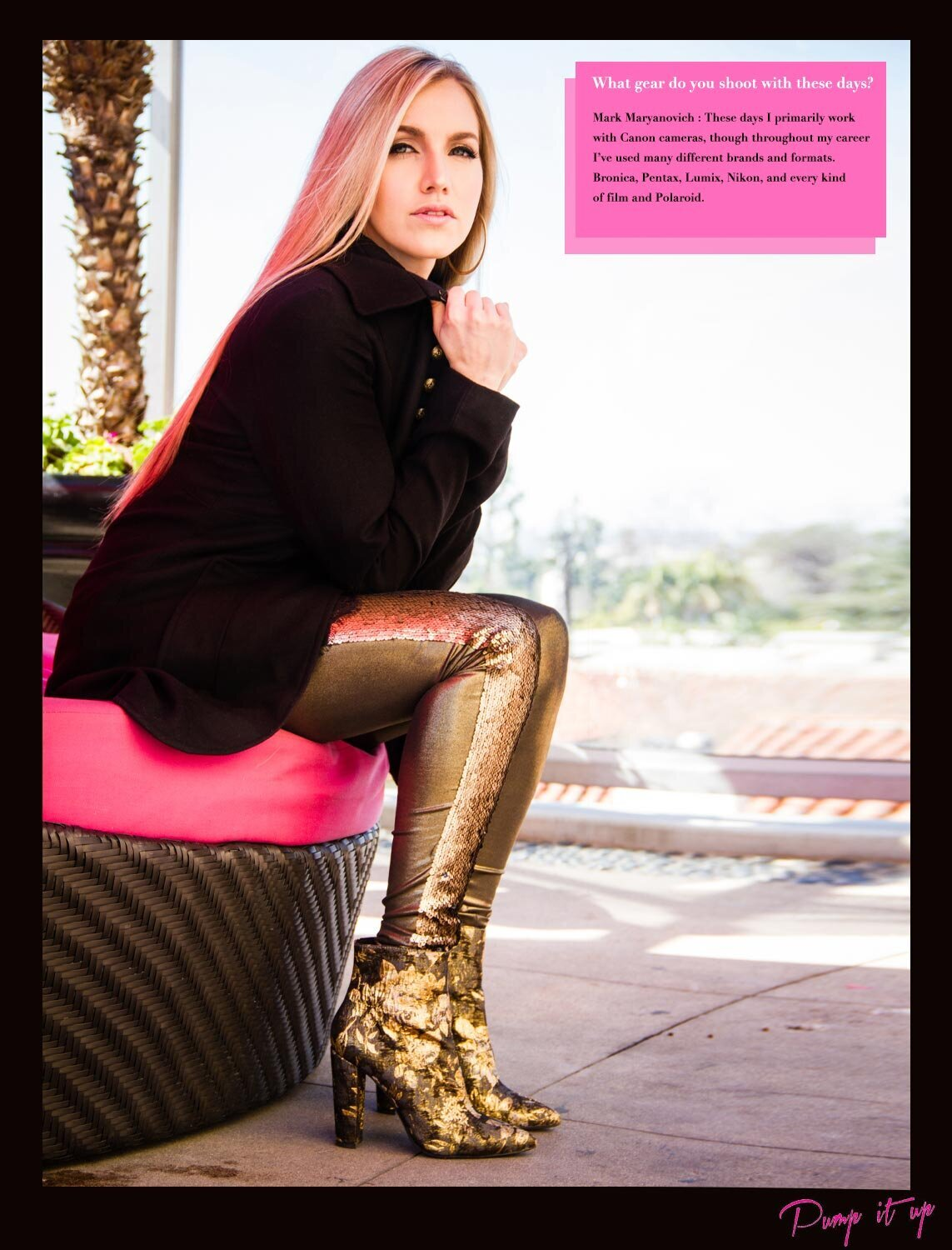 Pump It Up Magazine Interview featuring Mark Maryanovich female musician portrait seated on round chair with pink cushion wearing gold boots and holding lapels of black coat page 6