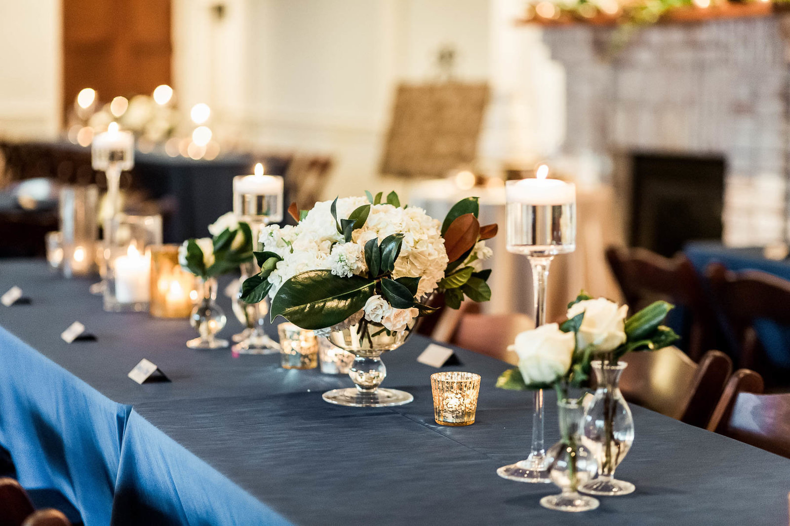 Beautiful floral centerpieces are on each table, Coleman Hall, Charleston Wedding Photography.