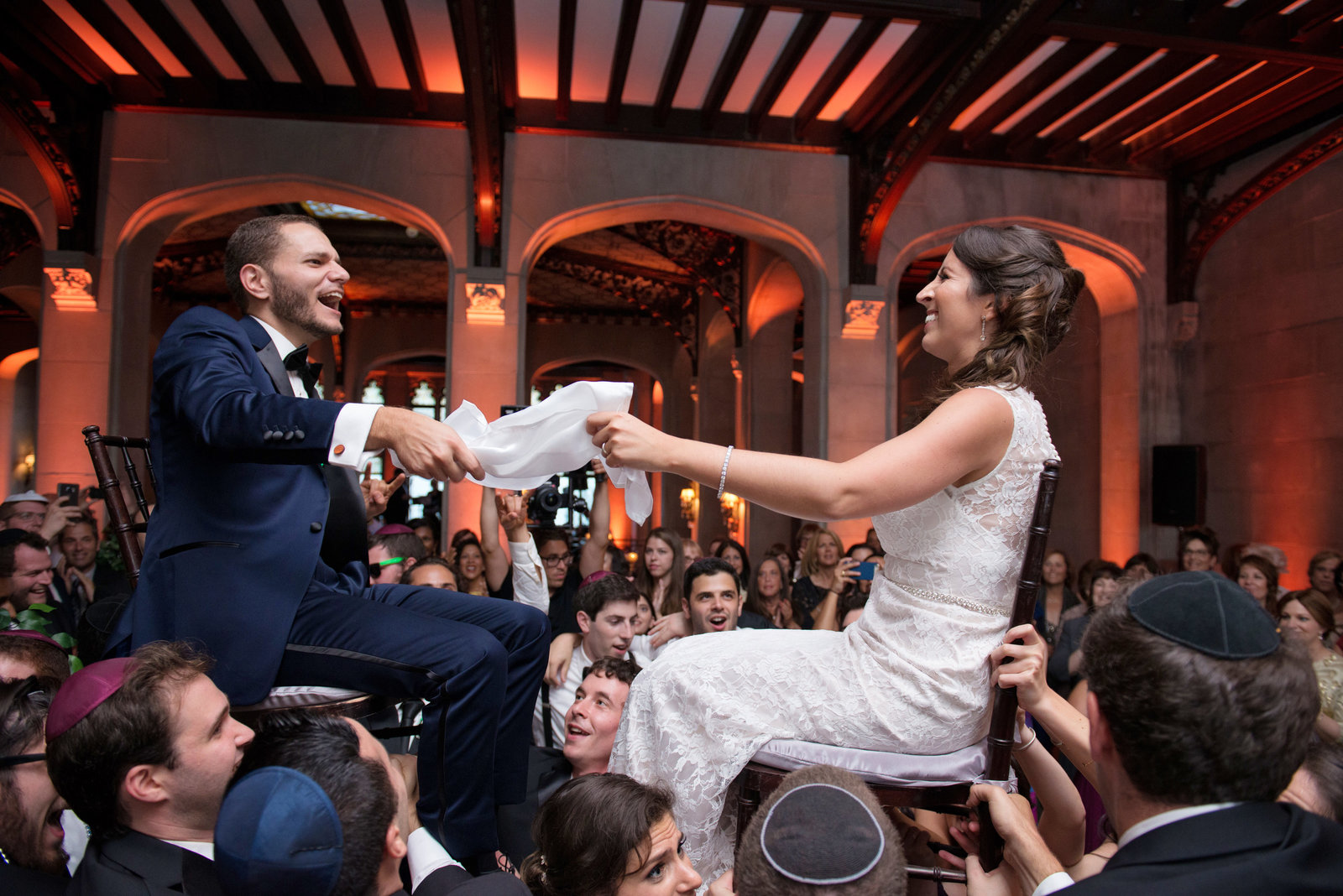 bride and groom dancing the hora during a jewish wedding