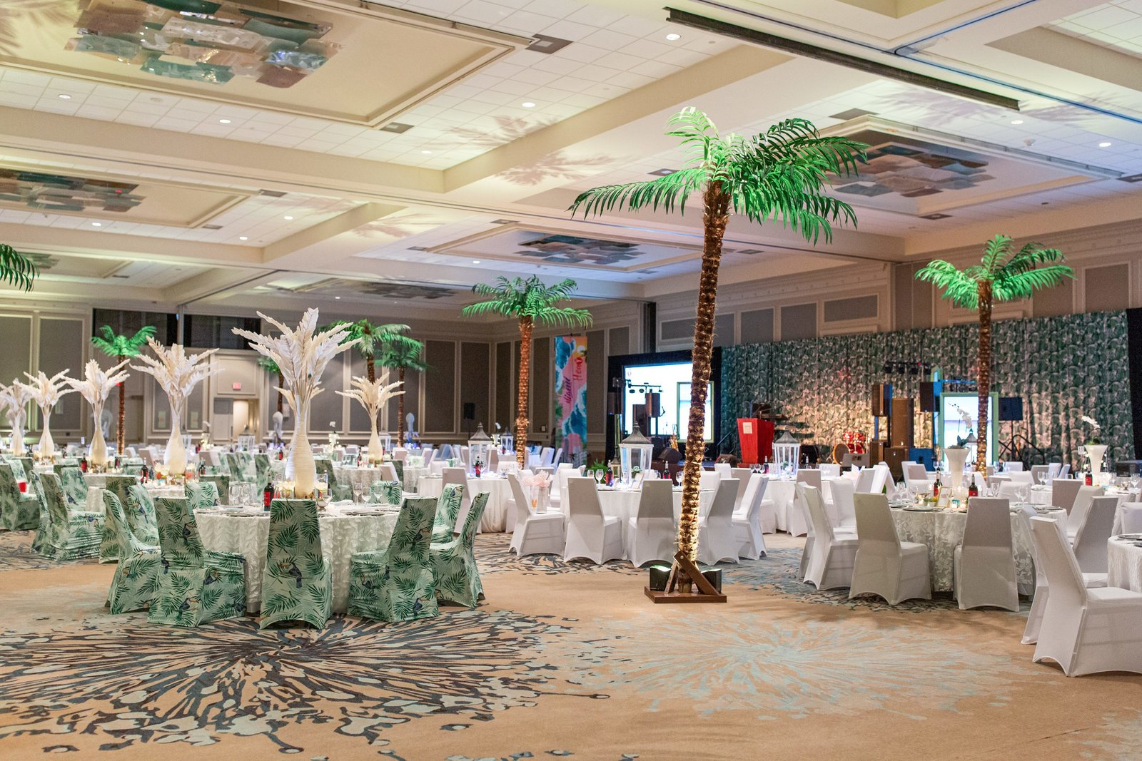 inside of a ballroom decorated for a gala