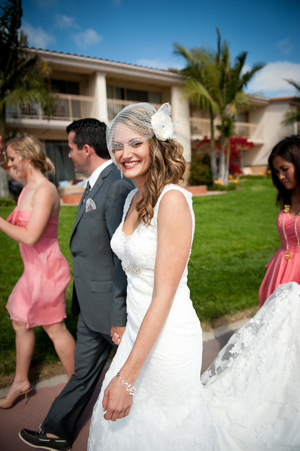 Bride walking with bridal party at hilton mission bay