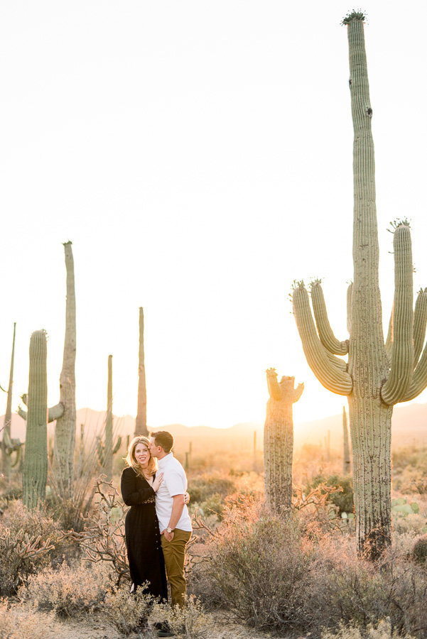 Gates Pass Tucson Desert Engagement Session Photo of Saguaro Cactus and Couple in Black Dress and White Shirt and Khaki Pants | Tucson Wedding Photographer | West End Photography