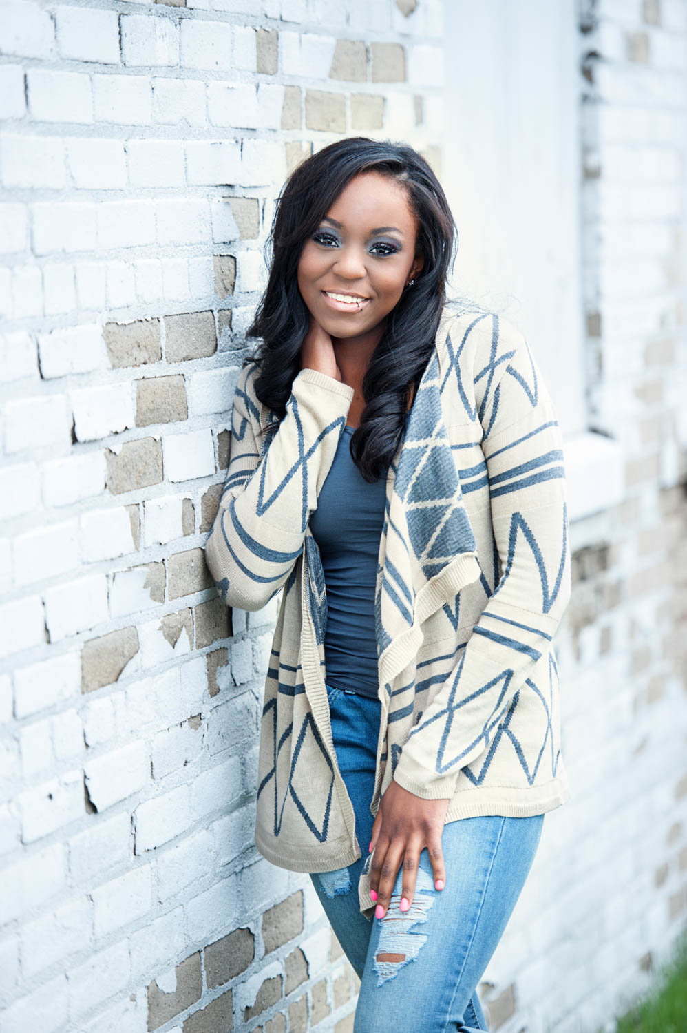 Casual senior picture of African American girl in sweater, smiling