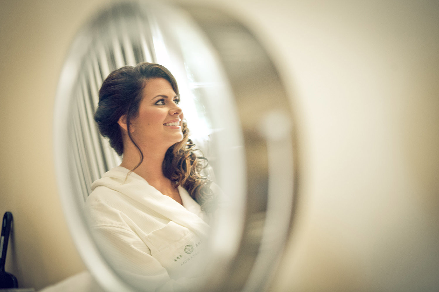 Framing the bride in the mirror